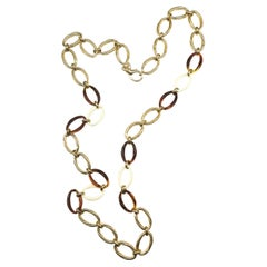 Very long gilt metal and plastic chain necklace, Christian Dior, 1980s.