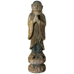 Very Old Carved Figure of a Female Standing Buddhist Immortal