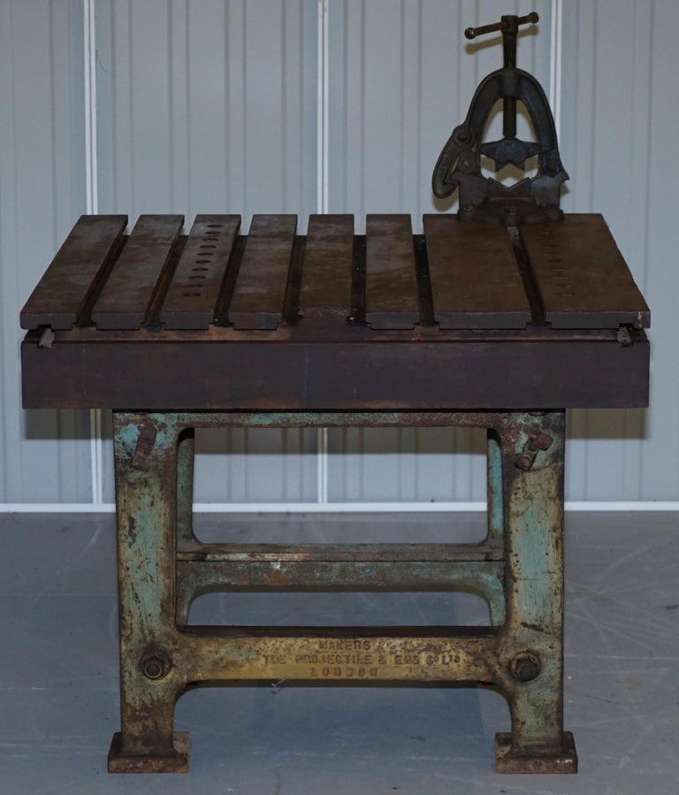 We are delighted to offer for sale this stunning and very rare industrial steel metal crimping work bench table made by The Projectile & Eng Co Ltd London makers of shells during world war 1  This table is immense, it must weigh 1-2 tones, it is