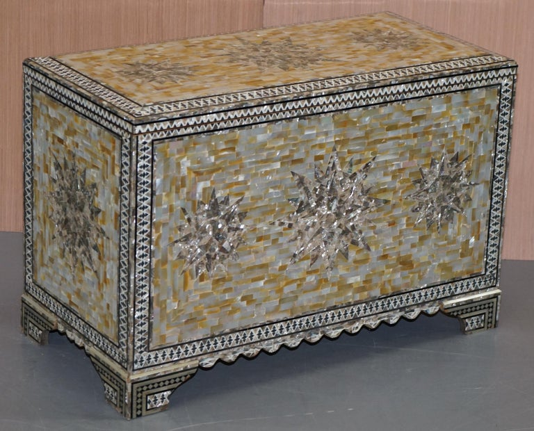 We are delighted to offer for sale this stunning very rare mother of pearl hand carved chest of trunk   A rare and exquisite piece, highly decorative, the mother of pearl when catching the light shines every colour of the rainbow  The pearl is
