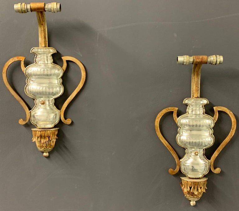 Huge wall lamps with gilt metal base and crystal glass elements.