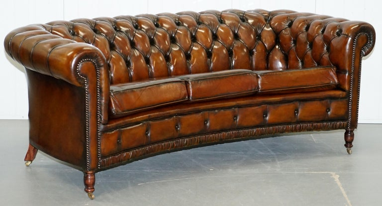 Wimbledon-Furniture is delighted to offer for sale this very rare vintage circa 1960s Curved front Chesterfield fully restored Cigar brown leather club sofa 