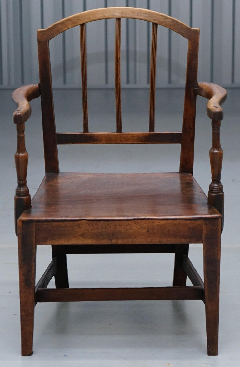 We are delighted to offer for sale this stunning George II circa 1760 oak carver chair with period repairs   A very good looking and well made chair, it all seems to be original timber including the stretches which have worn gloriously. There are