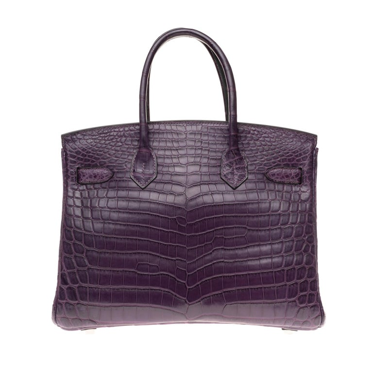 Gorgeous and rare Hermes Birkin Handbag 30 cm in Niloticus Crocodile Amethyst Matt, palladium metal trim, double handle made of Crocodile Amethyst allowing a handheld  Purple leather inner lining, one zipped pocket, one patch pocket Sold with