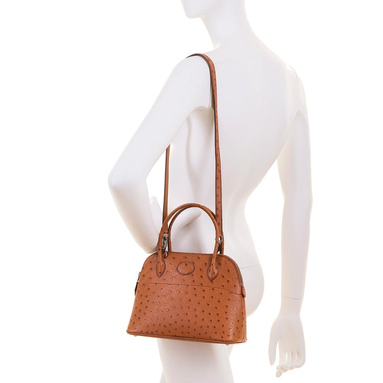 The Rare 'Mini' Hermes Bolide Bag - just 10in. wide, is very sought-after. This particular bag is made in exotic 'Miel' - Honey coloured Ostrich Skin. This dynamic leather, known for it's