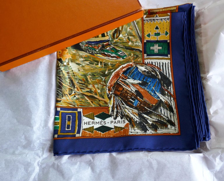 """Very Rare Hermes Silk Scarf """"Plumes de l'Ouest"""" by Kermit Oliver, 1993  Beautiful unworn Hermes """"Plumes de l'Ouest"""" by American designer Kermit Oliver.  This is an exquisite and rare design silk scarf from 1993, Navy Border, one for the"""