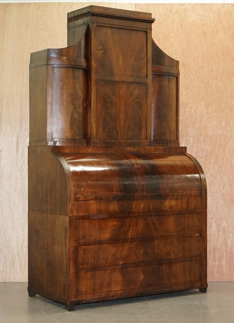 We are is delighted to offer for sale this very fine 19th century Italian cylinder top Bureau bookcase with ornately inlaid internals