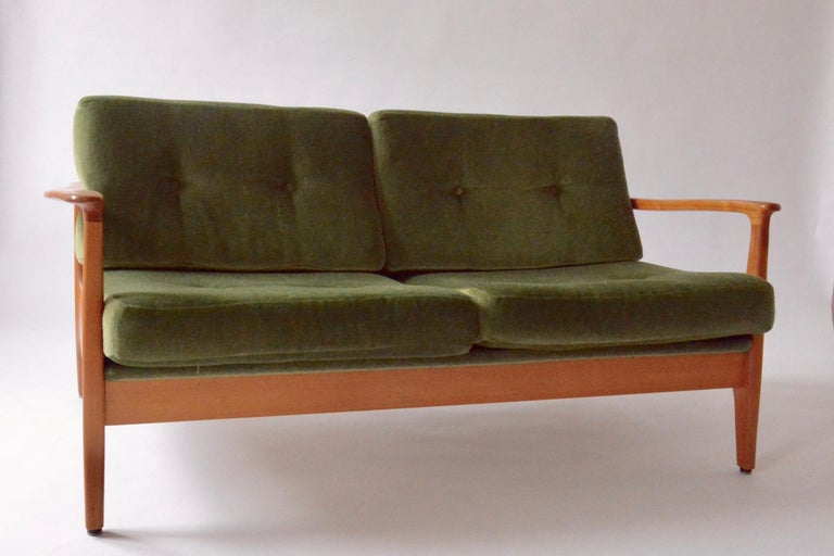 This very rare Eugen Schmidt 2-seater has a beautiful and organic shaped frame of massive cherry. The design was made for the German government buildings in the 1960s. As seen with mohair velvet cushions and very carefully handcrafted wooden