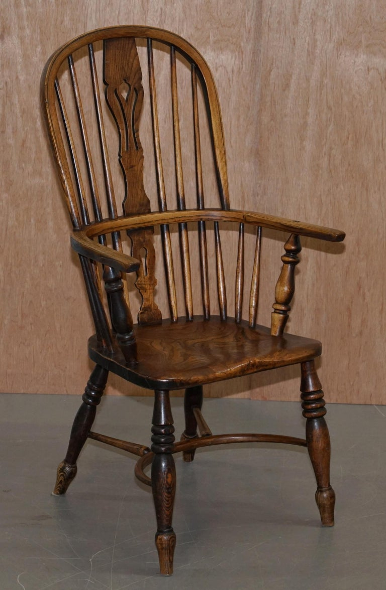 We are delighted to offer for sale this important and rare suite of eight original English circa 1860 Windsor armchairs in ash and elm
