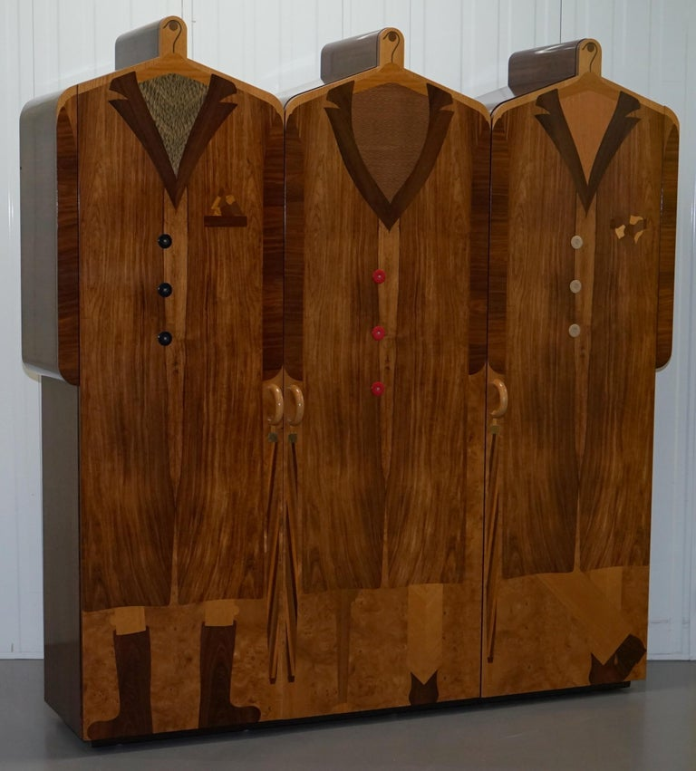 We are delighted to offer for sale this absolutely stunning original Signed and dated Andrew Varah 1989 Umbrella Men Rosewood wardrobe  This piece is pretty, the coolest piece of Art furniture I have ever seen, the pictures don't come close to