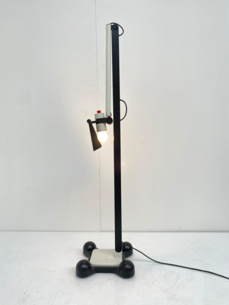 This very rare floor lamp is by Ettore Sottsass JR. and was created in 1973 as published in Domus n527 oktober p.88  The design of this floor lamp for Erco was his time ahead as it looks like it was made in the 1980's  Made of high quality cast