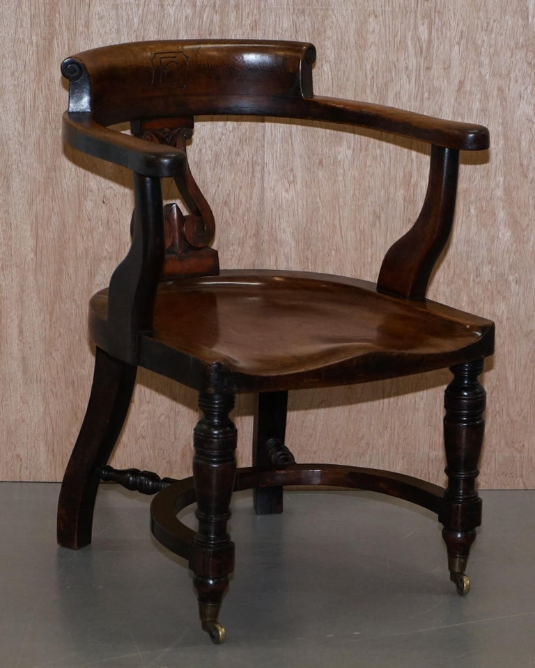 We are delighted to offer for sale this stunning and important suite of six original Victorian Walnut Eton College captains chairs each one carved with EC in the back rest  A substantial find, I have never seen one of these let alone a suite of