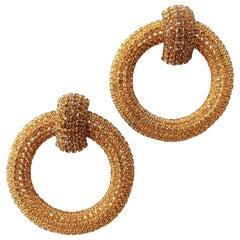 Very spectacular golden paste 'hoop' earrings, Roger JeanPierre, France, 1960s.
