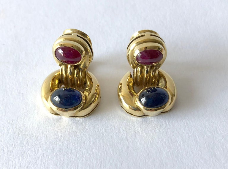 Door knocker earrings featuring oval-shaped ruby and sapphire cabochons set in 18k gold.  Signed Vesco, 750.  In very good vintage condition.  25.3 grams.