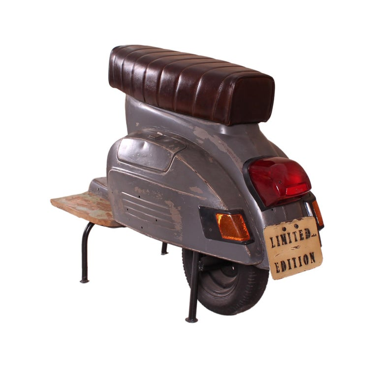 Completely crafted in Germany, this whimsical bar stool is designed in the shape of a scooter. With a vintage western style this piece is suitable for residential as well as commercial spaces.  Material: Painted metal, artificial leather Color: Dark