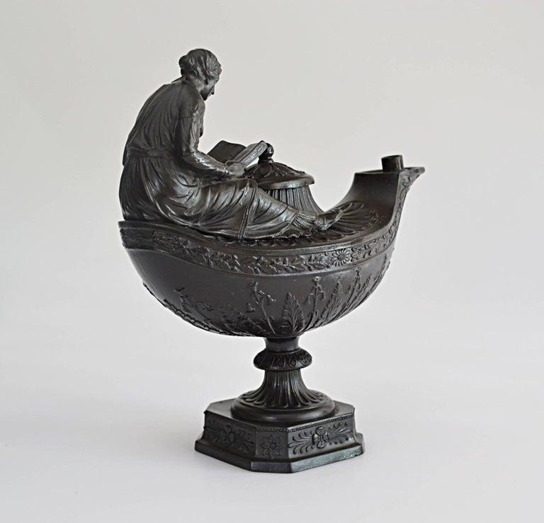 A finely modelled lamp in black basalt.  Provenance: Mcdonald Penney Collection; Alan Landis Antiques.