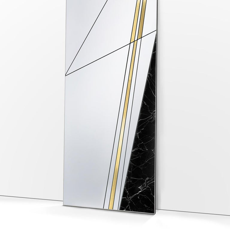 Part of a series of floor mirrors with a bold and sophisticated design, this piece will add an elegant decoration in a contemporary entryway, study, or living room. Its rectangular shape, supported by a wooden base, is made up of a series of