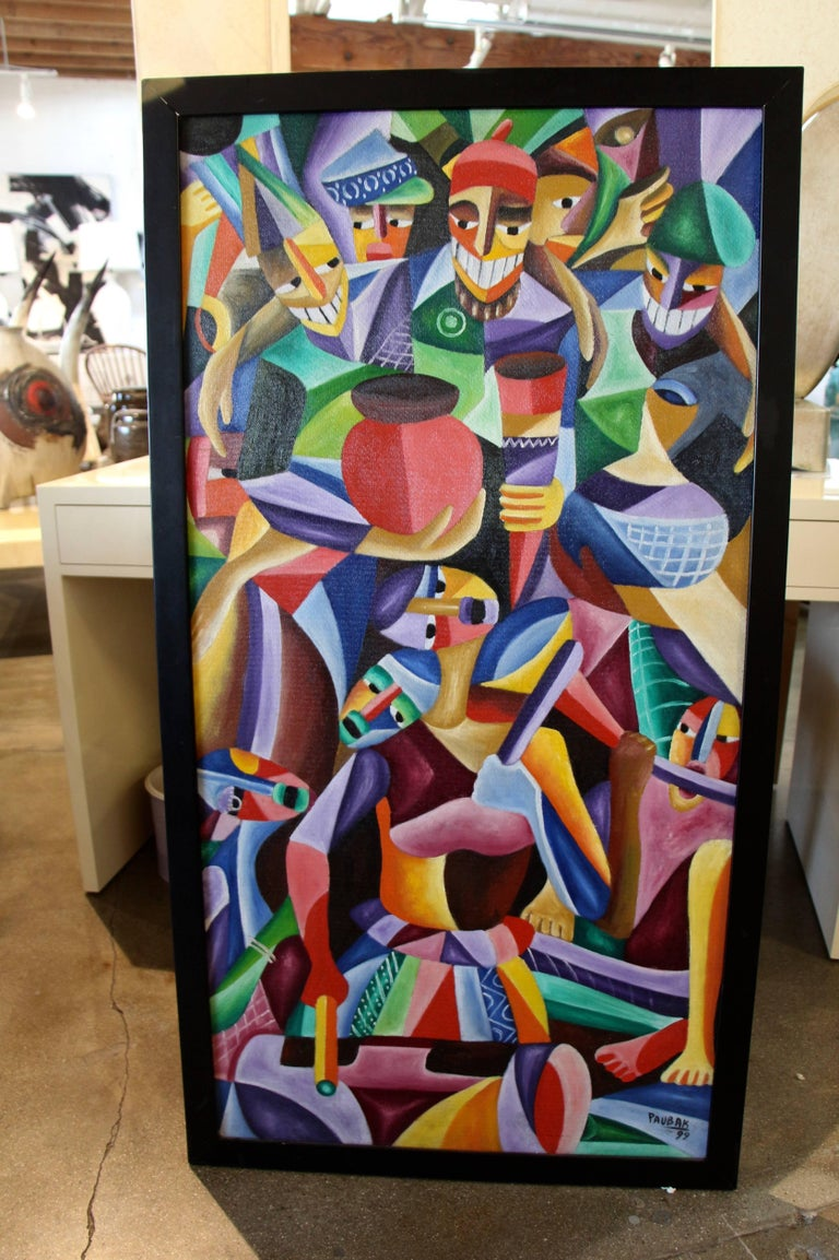 A nice vibrant cubist painting signed Paubak. Painted on board. It is framed in a simple black frame that has losses and has been retouched in areas. The corners of the frame do not meet flush. Minor losses to the paint.