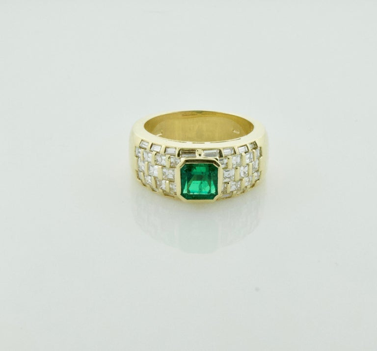 Vibrant Emerald and Diamond Ring in 18k Yellow Gold One Square Cut Emerald Weighing 1.15 Carats Approximately [bright with no imperfections visible to the naked eye] Thirty Eight  Baguette and Square Cut Diamonds Weighing 1.00 Carats Approximately