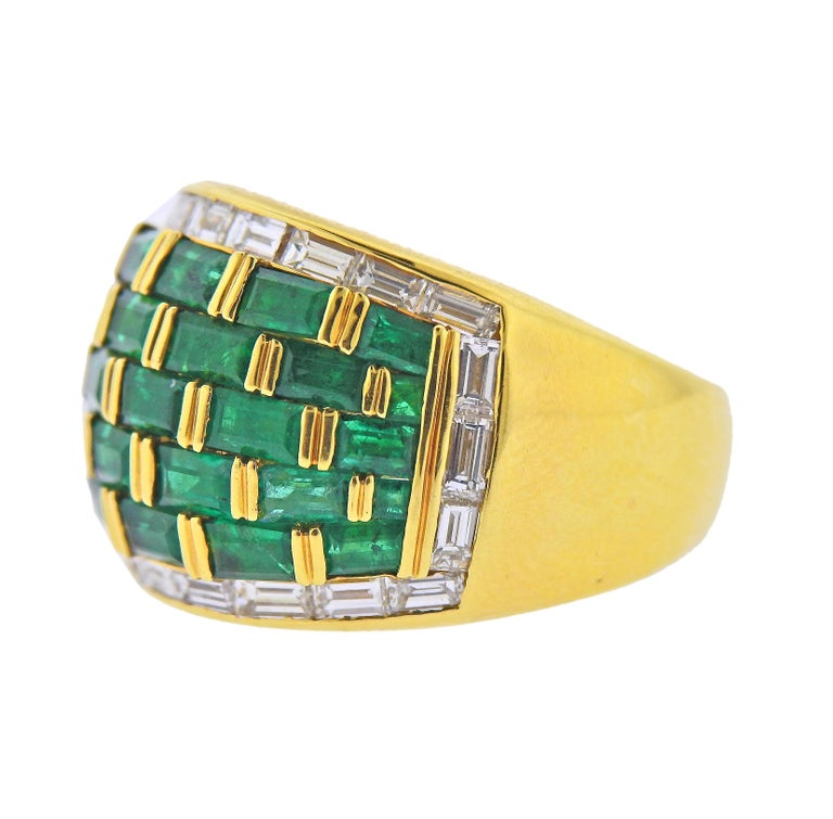 18k yellow gold dome ring, set with baguette cut vibrant emeralds and approx. 0.64ctw in diamonds. Ring size - 6.5, ring top is 15mm wide. Marked: 750, Illegible marks on the outside of the shank. Weight - 12.5 grams.