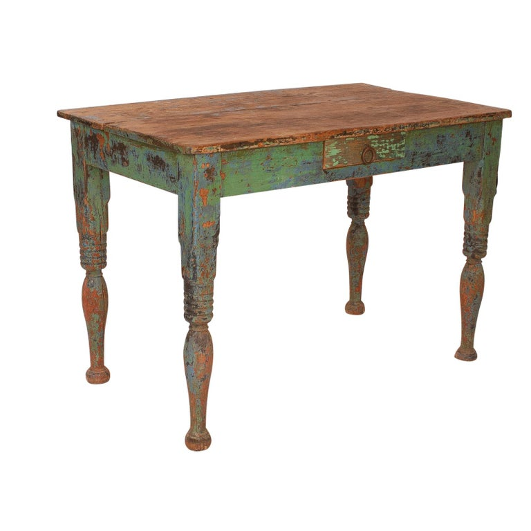 A late 19th century Spanish Colonial green painted pine work table, with one drawer, circa 1880.