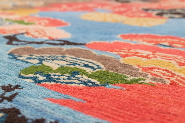 Nepalese Vibrant Blue, Orange, yellow and Brown Modern Wool Floral Area Rug For Sale
