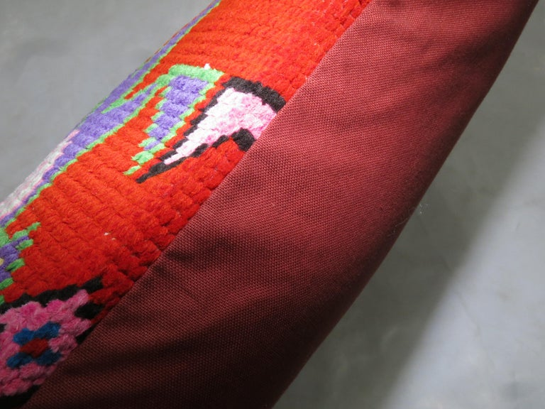 Large pillow made from a vintage Turkish Anatolian rug. Measures: 16 x 32''.
