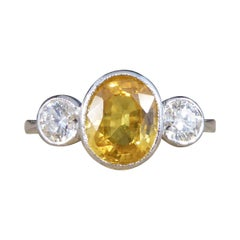 Vibrant Yellow Sapphire and Diamond Three Stone Ring in Platinum