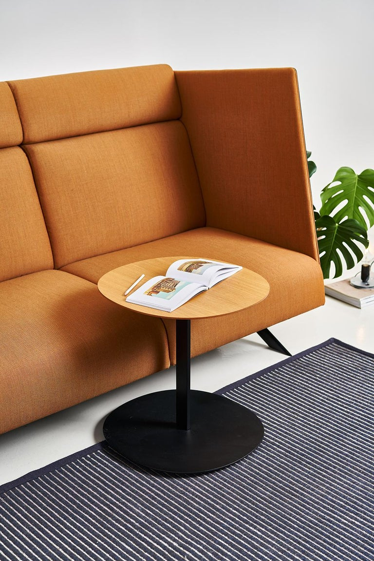 Ideal for supporting your laptop or simply enjoying a cup of coffee. Its finish naturally fits in a wide variety of spaces.   The column in a calibrated powder-coated steel tube in thermoreinforced polyester in black. Top in matte oak veneer.   Made