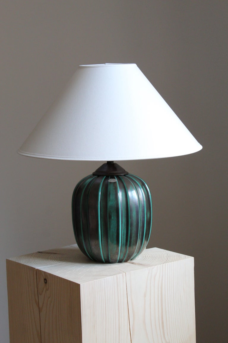 An early modernist table lamp. Designed by Vicke Lindstrand, for Upsala-Ekeby, Sweden, 1940s. Stamped and labeled.  Sold without lampshade, stated dimensions excluding lampshade.  Other designers of the period include Ettore Sottsass, Carl Harry