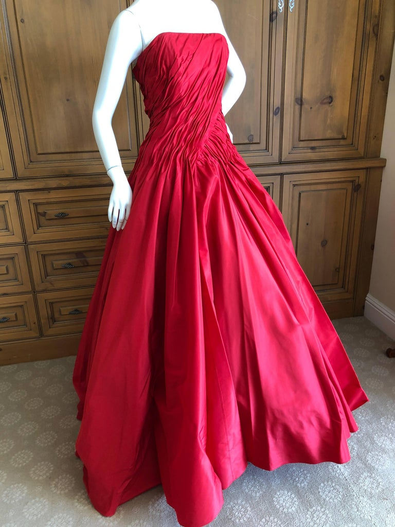 Wonderful red silk strapless evening gown from Vicky Teil Couture Paris. This has a built in inner corset  and zips up the back. There are four petticoats to hold the skirt full, and it stands by itself it is so fully constructed. Please use the