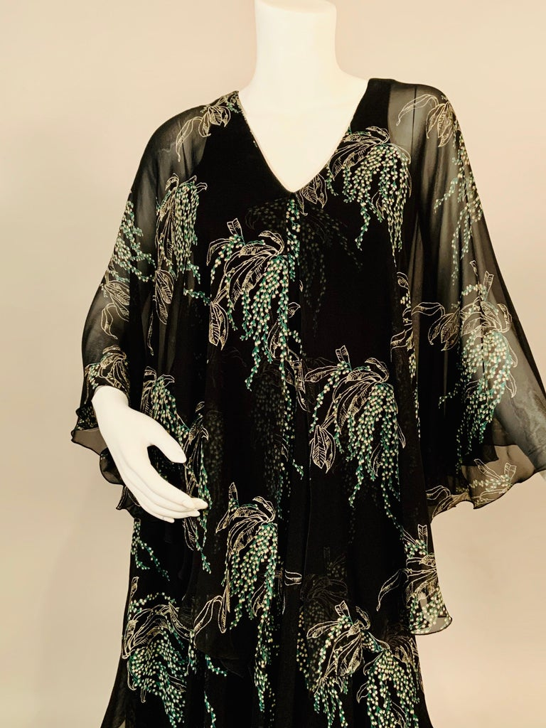 Vicky Tiel was an American designer in Paris for many years. This dress is from her boutique on the rue Bonaparte. The construction is very clever. She has used a black silk jersey slip dress underneath and three cascading layers of black silk