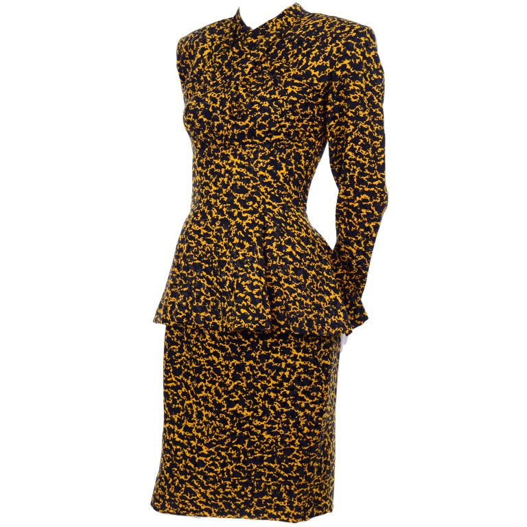 This is a vintage Vicky Tiel Couture silk skirt suit originally purchased at Bergdorf Goodman in the 1980's. This lovely suit looks like a dress when worn. The outfit is in a 100% silk black and yellow abstract print that resembles an animal print,