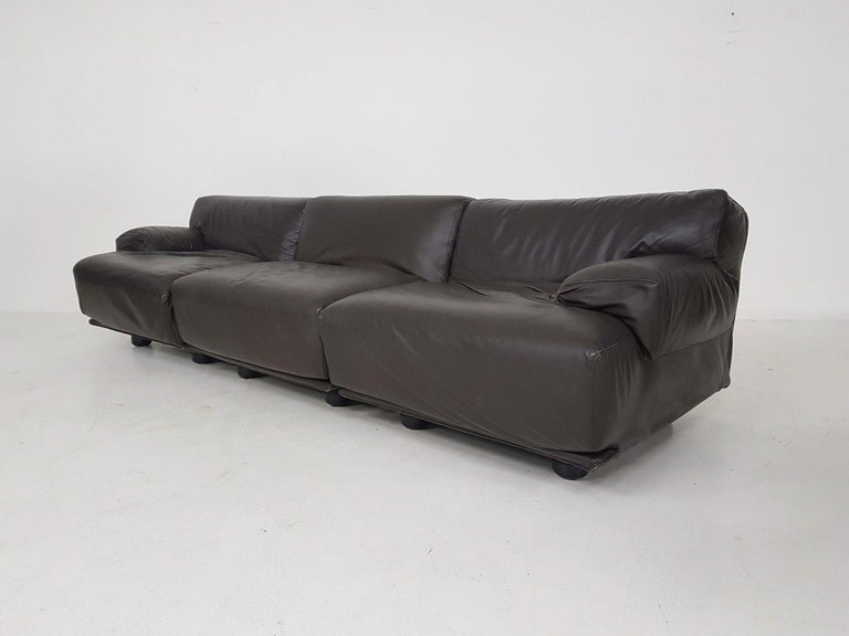 Comfortable leather sofa by Vico Magistretti for Casina. Made and designed in Italy in the 1970s.   Vico Magistretti was an Italian industrial designer and well known for his impressive lighting and furniture designs. Some famous design by his