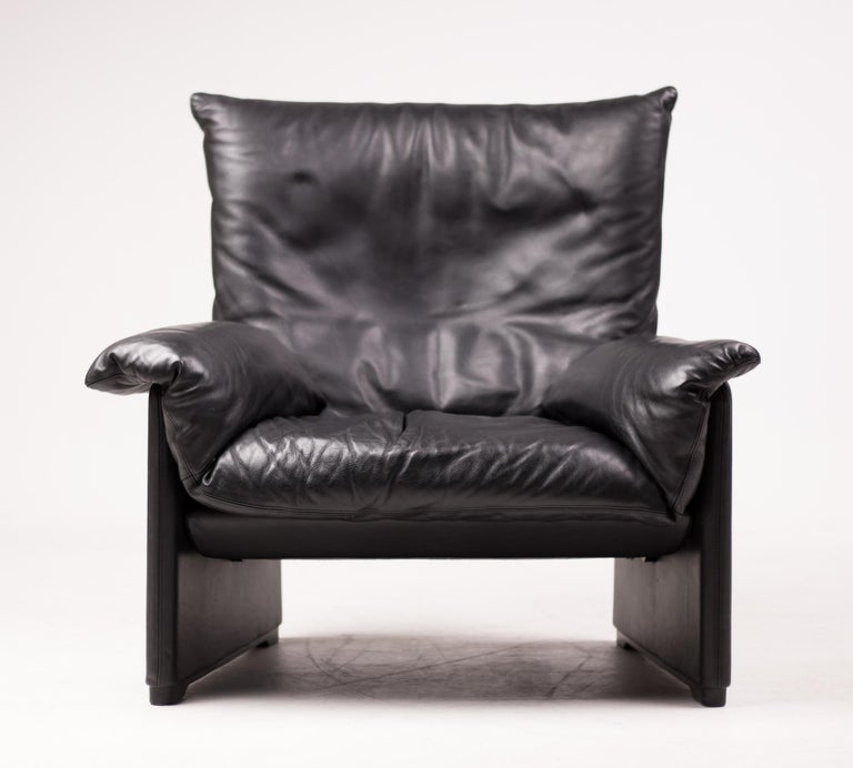 Very comfortable lounge chair designed by Vico Magistretti for Cassina. The original leather is in beautiful vintage condition, giving it that great casual look of an old baseball mitt. Marked with label.