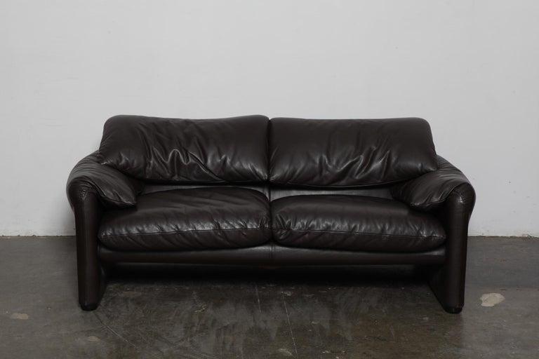 Brown 2-seat Maralunga sofa in original leather, designed by Vico Magistretti for Cassina, Italy - Model 675 Maralunga 40, designed in 1973. Measures: Seat depth 23.25''.