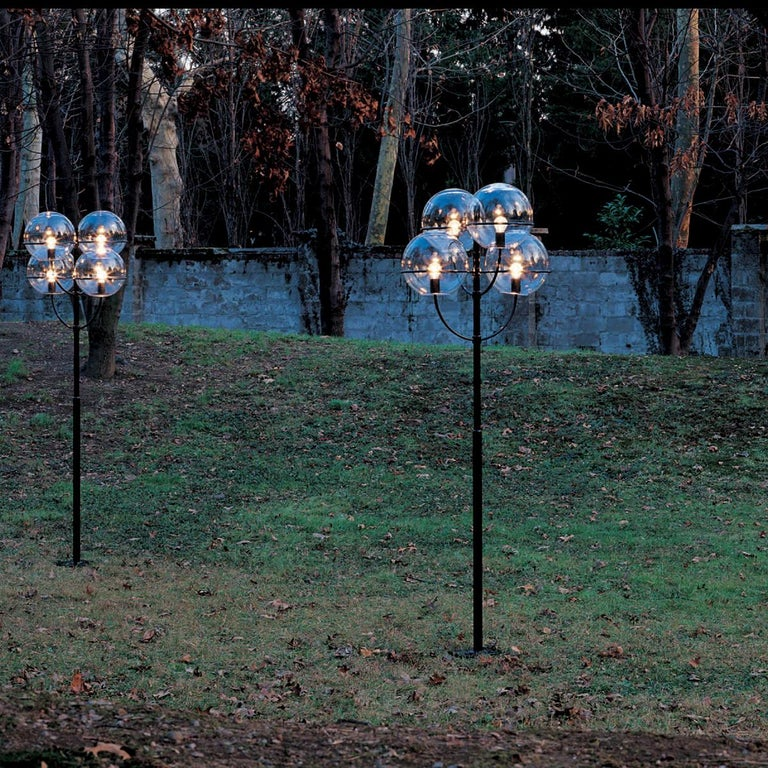 Outdoor lamp 'Lyndon 350 M' designed by Vico Magistretti in 1977. Outside floor lamp. Zinc-plated black lacquered metal structure, globes in transparent polycarbonate. Manufactured by Oluce, Italy.