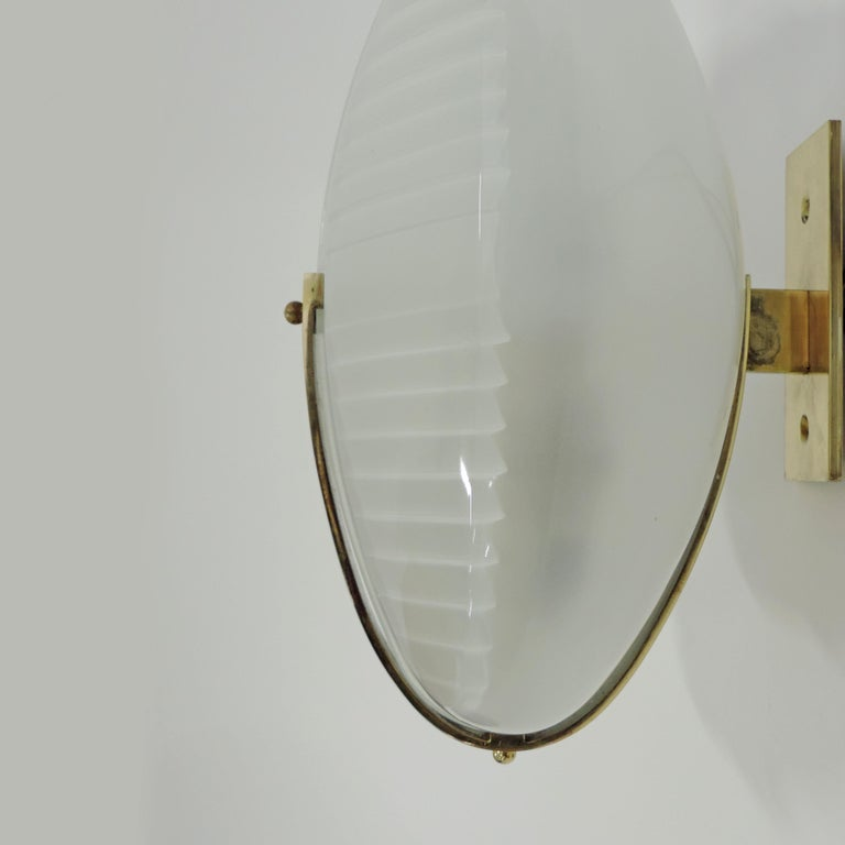 Vico Magistretti pair of Lambda wall lights for Artemide, Italy 1961 Brass structure and pressed glass diffusers. Manufactured by Artemide in 1961.