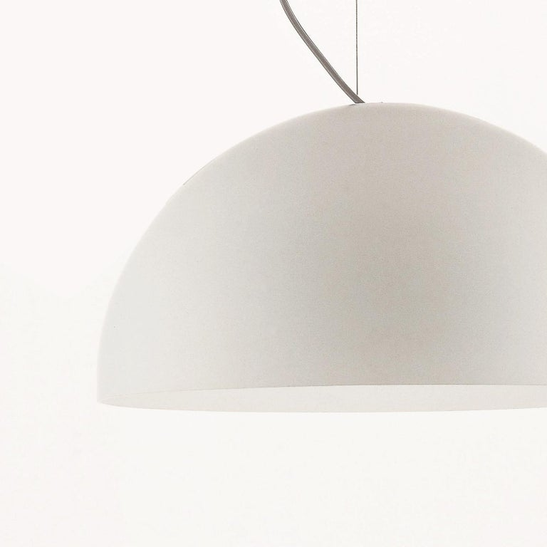Suspension lamp 'Sonora' designed by Vico Magistretti in 1976. Suspension lamp, giving direct and diffused light in blown PMMA. Manufactured by Oluce, Italy.  The story of Sonora is one of a pure geometrical shape, pursued by Magistretti