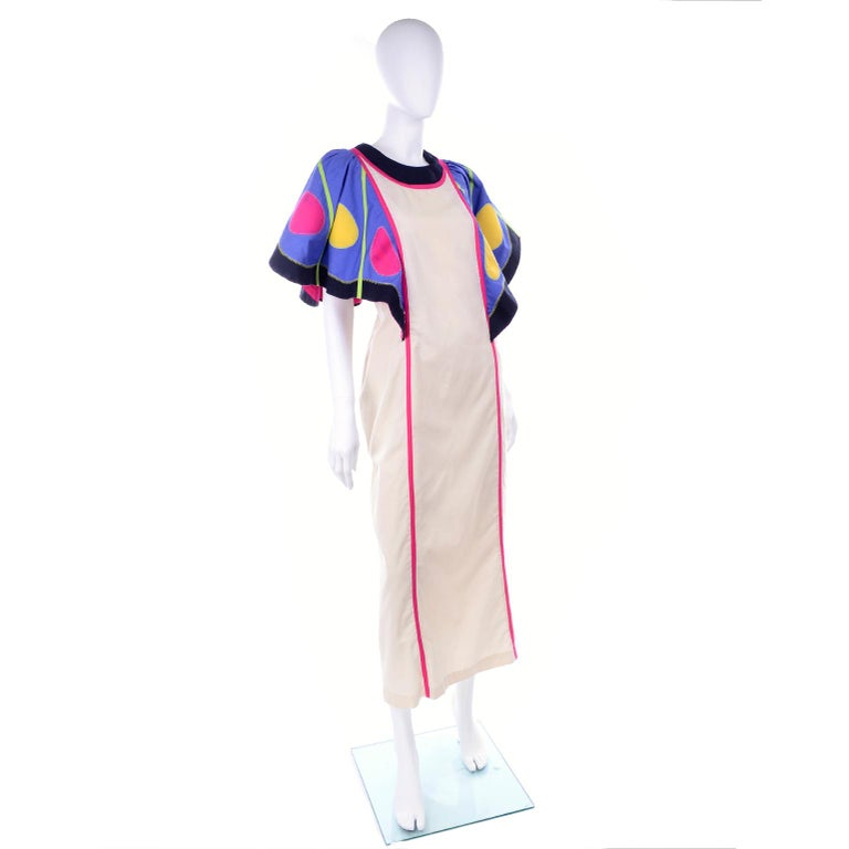 This is a fabulous vintage Victor Costa natural cotton maxi dress with blue butterfly wing sleeves with multi colored spots! The dress has the Victor Costa at home tag, which means it was originally designed to be worn as a hostess gown, but it is a