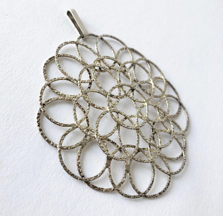 Sterling silver circular lacy pendant created by Victor Janson of Sweden, circa 1970's. Pendant measures 3