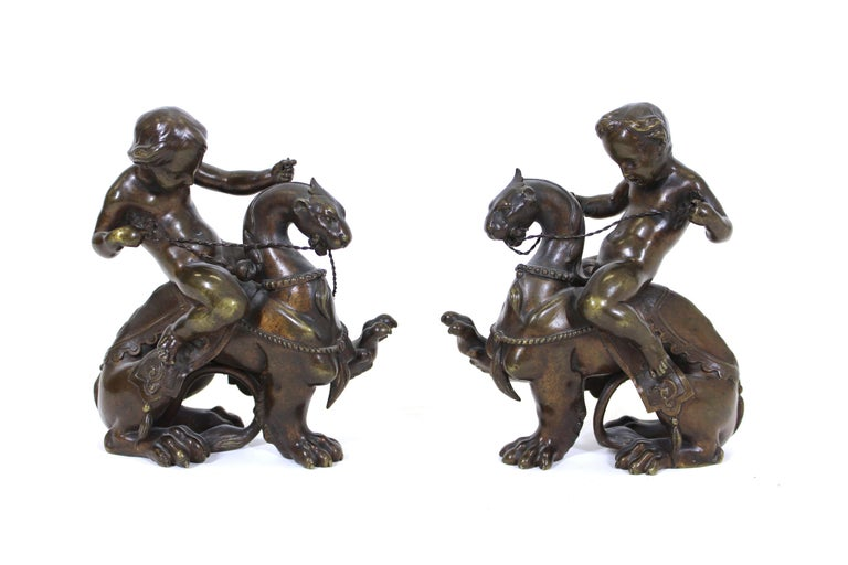 Victor Paillard French Renaissance Revival bronze pair of putti riding chimeras, circa 1860. Stamped on the bottom with makers mark (Crown over V P initials). Paillard was one of the most important French bronze founders of the mid-19th century.