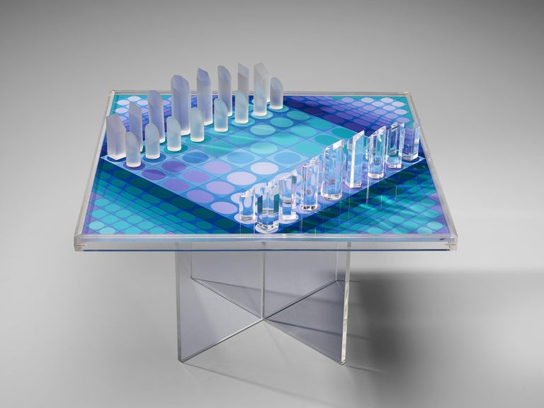 Victor Vasarely, chess set, plexiglass, France, 1979  Victor Vasarely (1906-1997), one of the important artists of the optical art, designed this chess set in 1979. On a cross-legged plexiglass base rests the squared chess board with 32 pieces. A