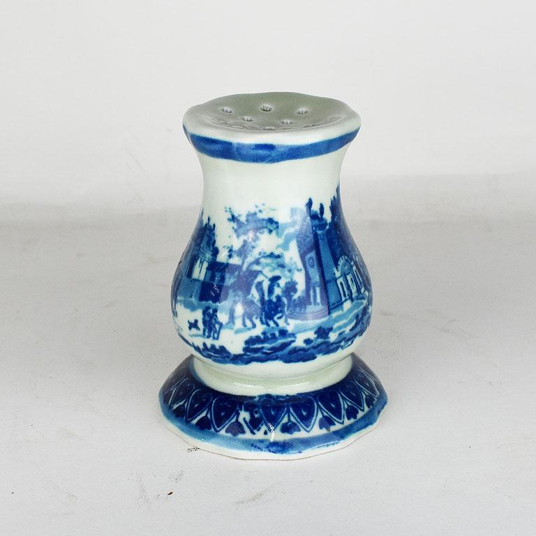 A staple in the ages where hats were the finishing touch to an outfit. This beautiful piece of ironstone 'flow blue' stoneware is tall in stature and features small pierced holes at the top for holding hat pins. 
