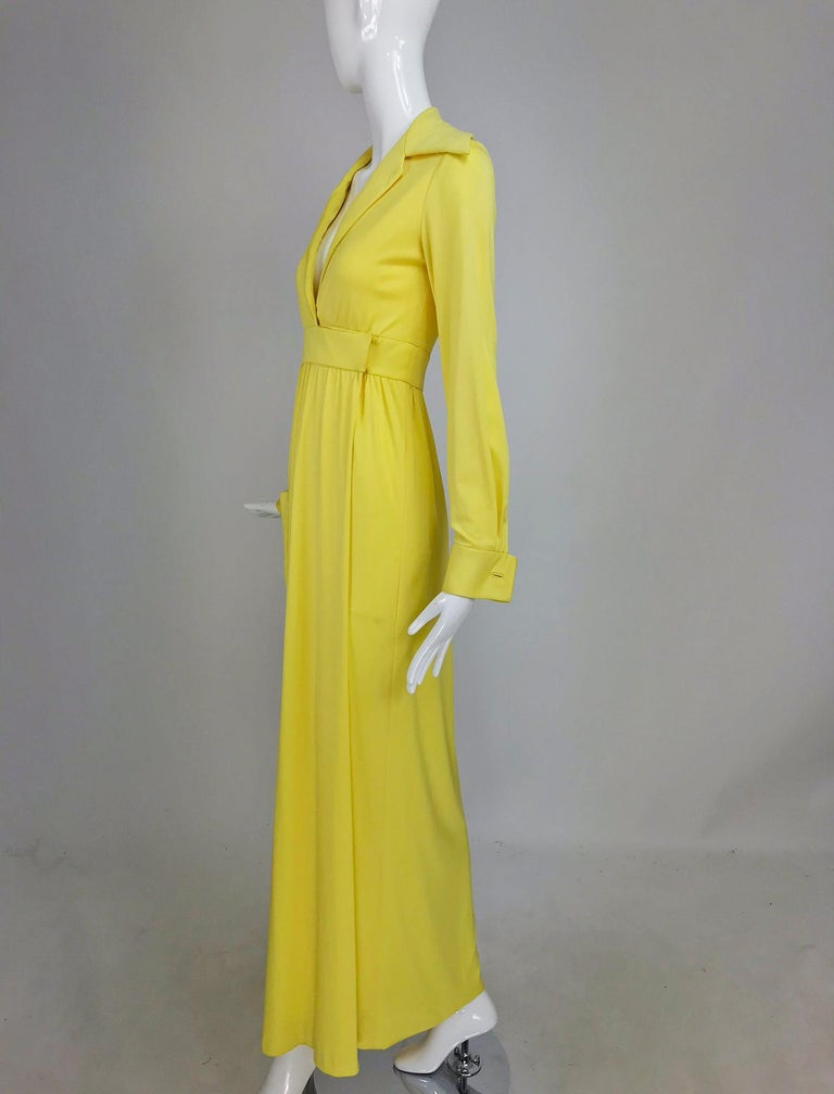 Victoria Royal/Lillie Rubin yellow jersey plunge wrap maxi dress from the 1970s. This dress was made by Victoria Royal Hong Kong and retailed at Lillie Rubin. Sunny yellow silky knit jersey wrap dress. Plunge neckline with a wide lapel collar, long
