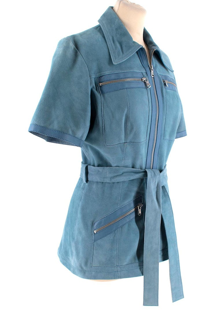 Victoria Victoria Beckham Blue Suede Leather Shirt   - Belted leather short sleeves shirt in light blue colour  - Multi pockets at front  - Zip fastening at front  - Classic neckline with a collar   Materials: 100% Suede trim: 100% lamb
