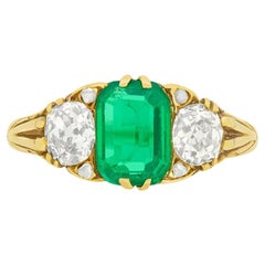 Victorian 1.10 Carat Emerald and Diamond Three-Stone Ring, circa 1880s