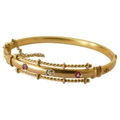 Victorian 15 Carat Yellow Gold Hinged Ruby and Diamond Bangle