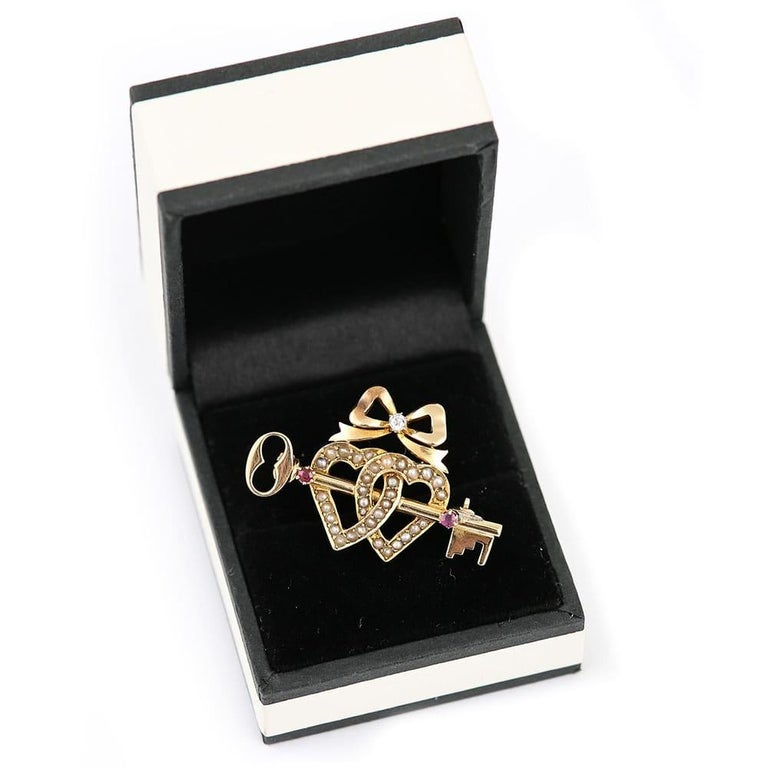 Victorian 15 Karat Gold Pearl Dual Sweet Heart, Ruby Key and Diamond Bow Brooch For Sale 6