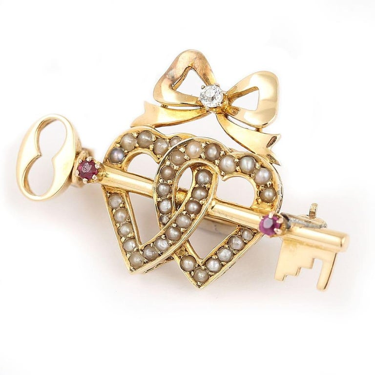 Old European Cut Victorian 15 Karat Gold Pearl Dual Sweet Heart, Ruby Key and Diamond Bow Brooch For Sale